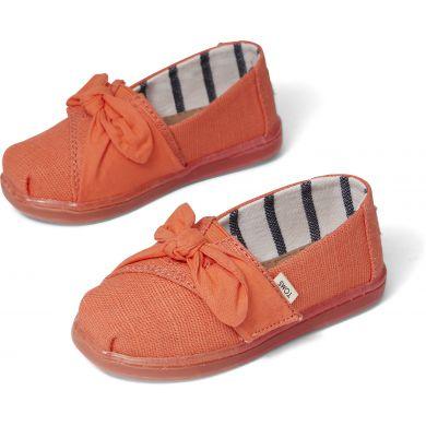 Dětské oranžové plátěné espadrilky s mašlí TOMS Tiny Alpargata