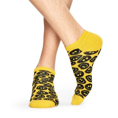 Žluto-černé ponožky Happy Socks se smajlíky, vzor Twisted Smile